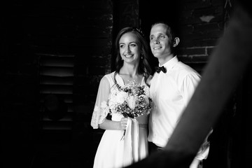 Black and white picture of newlyweds standing in the shadow