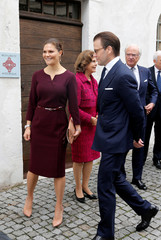 Sweden's Crown Princess Victoria and Prince Daniel, Sweden's King Carl XVI Gustaf and Queen Silvia pose in front of the Bernadotte Museum