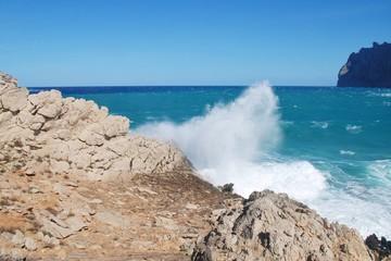 Stormy seas spray over the cliffs by Molin beach at Cala San Vicente on the Spanish island of Majorca.