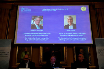 Per Stromberg, Goran K. Hansson and Per Krusell announce the laureates of the Nobel Prize in Economics during a press conference at the The Royal Swedish Academy of Sciences in Stockholm