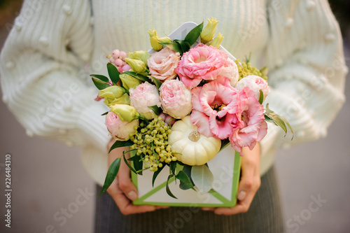 Girl Holding A Box Of Pink And Green Flowers Decorated With Pumpkin