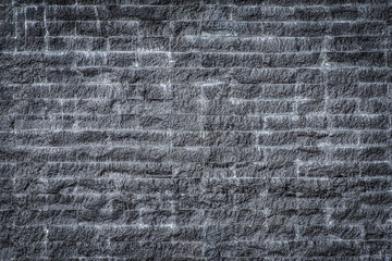 black brick wall old dark stone texture. gloomy background in city