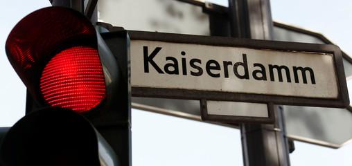 A traffic light is seen beside a road sign at Kaiserdamm street in Berlin