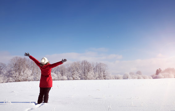 Happy woman in winter landscape on snowy landscape. Person outdoors on sunny day