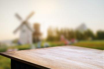 empty wooden table over blur mantage garden background