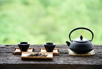 set Chinese tea on the old wood table green nature background
