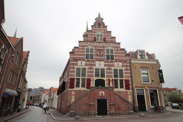 Old ancient buildings like churches and city hall of town of Oudewater where in the middle ages witches were burned