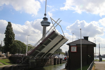 Open Bridge at the Parksluis sluice which connects the Oude Maas river to the Rijn Schie canal in the Harbor of Rotterdam with Euromast on the background