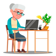 Elderly Woman Sitting At Table And Working With Laptop Vector. Isolated Illustration