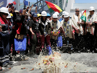 Bolivian authorities break vessels with drinks as part of a tradition to inaugurate an industrial plant for potassium chloride, in Llipi