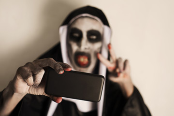 frightening evil nun taking a selfie