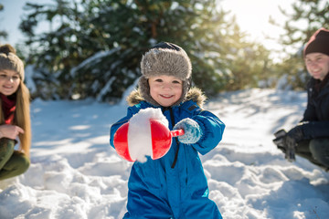 Happy cute little boy have fun in snow under parental advisory