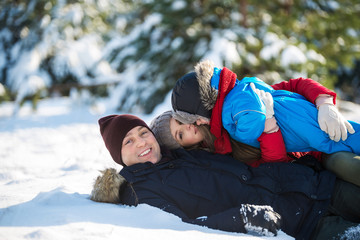 Happy family lying on snow