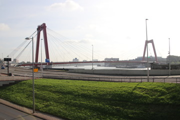 The red willemsbrug bridge in Rotterdam over river Nieuwe Maas to connect North part to the northern island named Noordereiland in the Netherlands