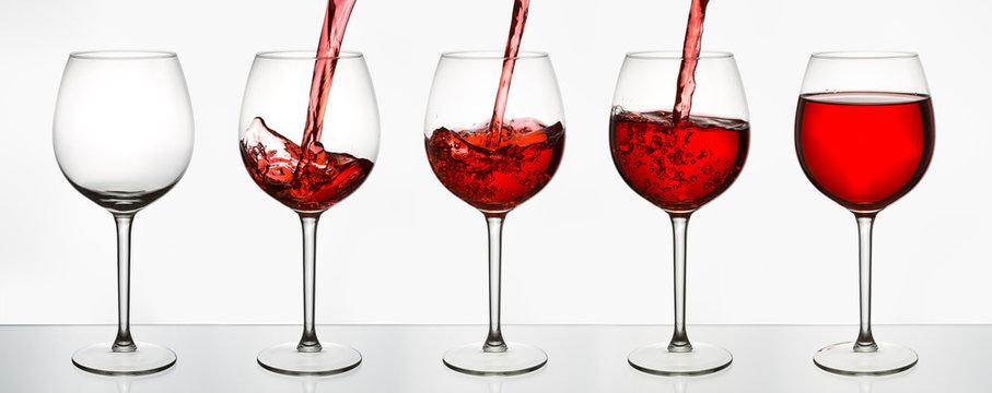 Beautiful splash of red wine in glasses