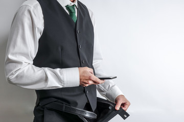 Businessman make a dick pic. Pervert man taking a picture of his penis with a smart phone. Copy space on white background.