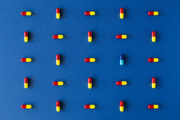 Graphic colourful pill composition on a solid blue background
