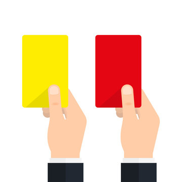 Soccer referees hand with red and yellow card