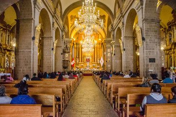 Cusco, Peru; January 22, 2017: Inside of La Merced Convent with chandeliers, pulpit and altar in Cusco, Peru