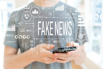 Fake news with young man using a smartphone
