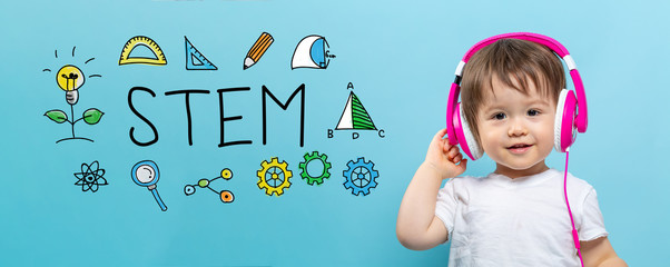 STEM with toddler boy with headphones on a blue background
