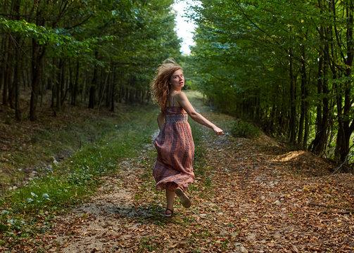 Scared girl running through forest