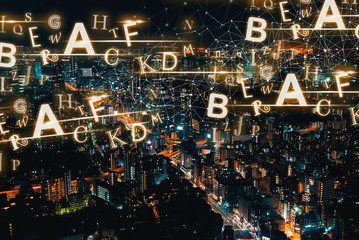 Alphabets with aerial view of Tokyo, Japan at night