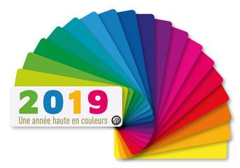 Carte de vœux 2019 utilisant le symbole du nuancier et son éventail de couleurs pour les peintre en bâtiment et les décorateur intérieur