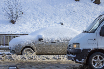winter cars,car covered with snow on the street