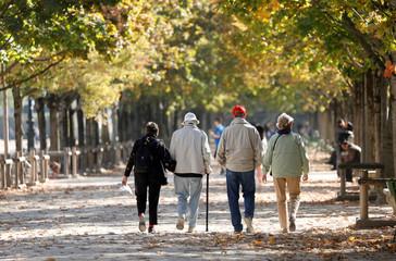 Elderly people walk in the Jardin des Tuileries on an autumn day in Paris
