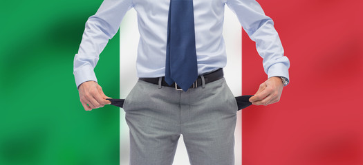 business, bankruptcy and finance crisis concept - close up of businessman showing empty pockets over flag of italy background