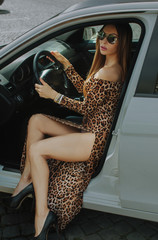 Beautiful brunette - the driver. Driving your car