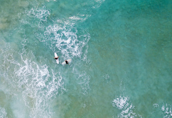 Two Surfers at sea - Aerial