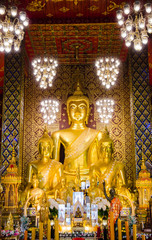 three giant buddha statue in church