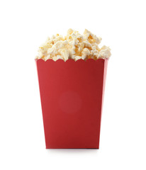 Red bucket with delicious popcorn on white background