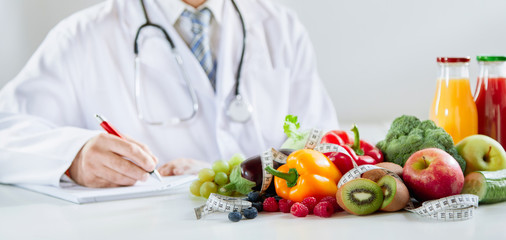 Doctor or dietitian writing a healthy food recipe