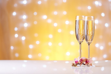 Champagne on a yellow background.
