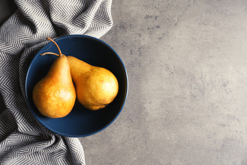 Flat lay composition with ripe pears on grey background. Space for text