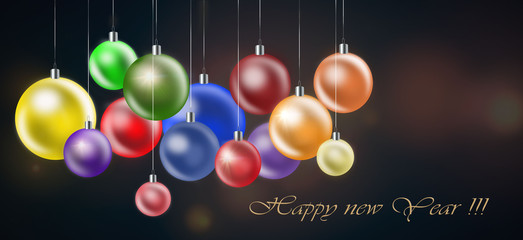 Christmas background with colored balls on dark background.