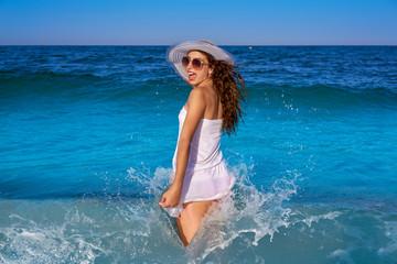Girl in beach sea shore with waves splash