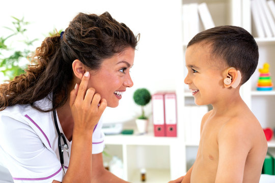 Pediatrician checking the configuration match of the hearing device