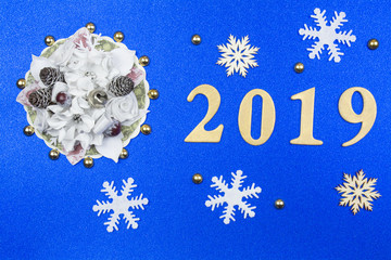 "Blue decorative background with new-year decorations and yellow figures ""2019""."