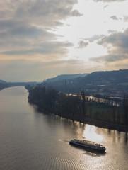 Ship boat on the Vltava river in Prague under sun shining