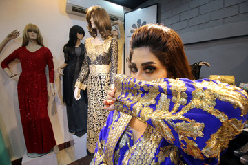 An Iraqi fashion model is seen during a photo session at a fashion centre in Basra