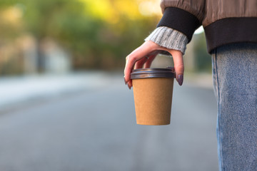 Women carrying brown paper cup