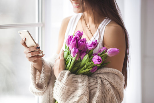 Unrecognizable young woman with flowers