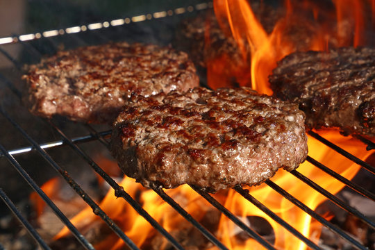 Beef burger for hamburger on barbecue flame grill