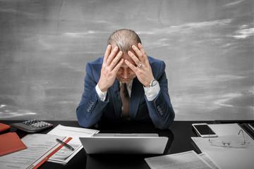 Portrait of desperate businessman in big trouble feeling lost