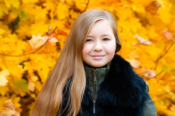 portrait charming girl with long hair in autumn