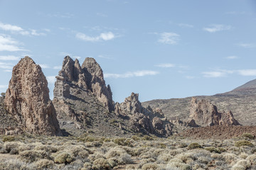 Group of large lava rocks in the middle of a special desert landscape, on a nice sunny day